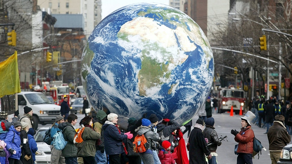 Protesters carry an inflatable globe during an anti-war demonstration February 15, 2003 in New York City. Tens of thousands attended the rally which coincided with peace demonstrations around the world.
