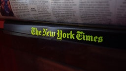 The New York Times logo is seen on a newspaper rack at a convenience store in Washington, DC, on August 6, 2019.