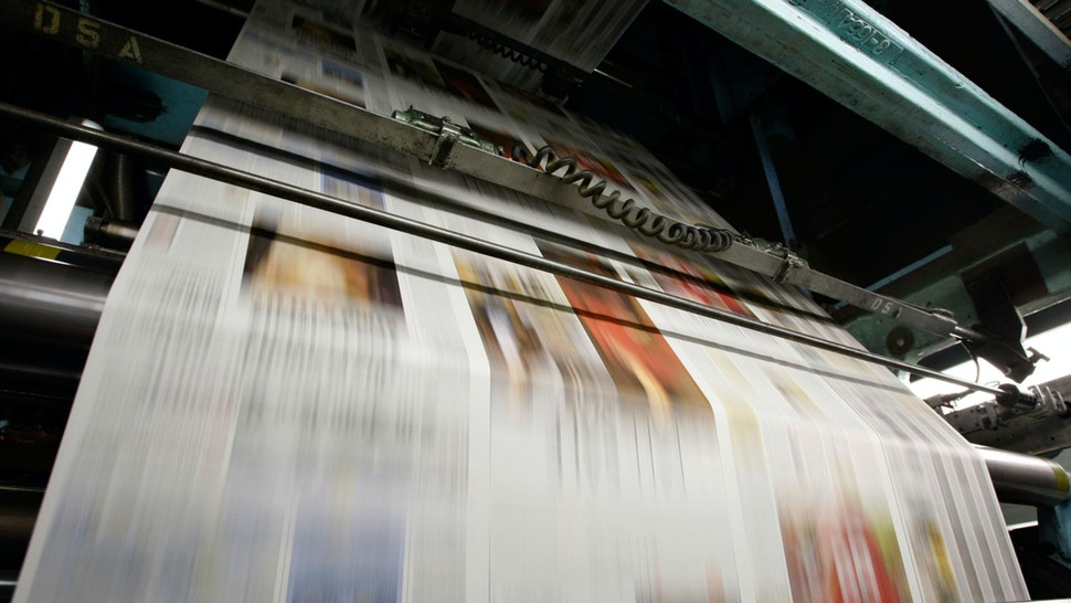 Freshly printed copies of the San Francisco Chronicle run through the printing press at one of the Chronicle's printing facilities September 20, 2007 in San Francisco, California.