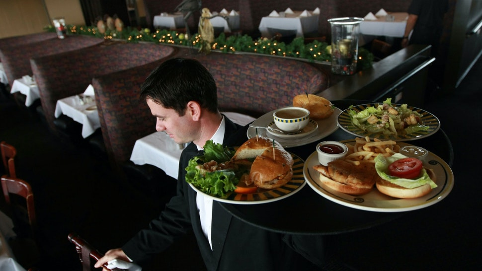 Waiter Alexander Alioto prepares to serve lunch to customers at Alioto's Seafood Restaurant December 3, 2008 in San Francisco, California.