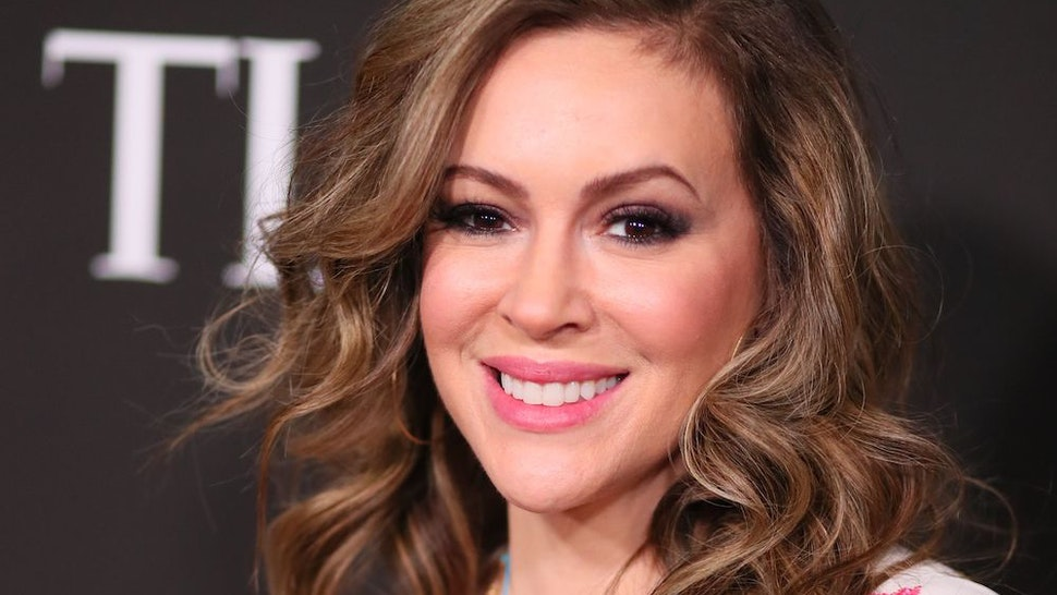 Actress Alyssa Milano arrives for the 10th Anniversary CORE (Community Organized Relief Effort) Gala at the Wiltern theatre in Los Angeles on January 15, 2020. - CORE (formerly known as J/P HRO) is marking the 10th anniversary of both the devastating 2010 Haitian earthquake and the subsequent founding of this organization by Sean Penn. (Photo by Jean-Baptiste LACROIX / AFP