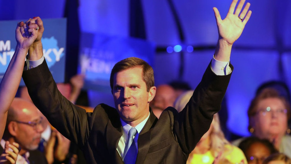 Apparent Gov.-elect Andy Beshear celebrates with supporters after voting results showed the Democrat holding a slim lead over Republican Gov. Matt Bevin at C2 Event Venue on November 5, 2019 in Louisville, Kentucky. Bevin, who enjoyed strong support from President Donald Trump, did not concede after results showed Beshear leading 49.2 percent to 48.8 percent, a difference of less than 6,000 votes, with 100 percent of precincts reporting. (Photo by John Sommers II/Getty Images)