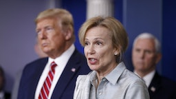 Deborah Birx, coronavirus response coordinator, speaks as U.S. President Donald Trump, left, listens during a Coronavirus Task Force news conference in the briefing room of the White House in Washington, D.C., U.S., on Friday, March 20, 2020.
