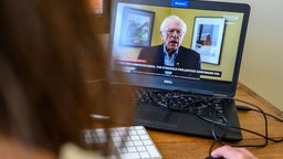 An AFP political correspondent working from home watches a video from the Bernie Sanders presidential campaign, as Sanders announces the suspension of his presidential campaign on April 8, 2020, in Washington. - US Senator Bernie Sanders has suspended his presidential campaign, his team said Wednesday, clearing the way for rival Joe Biden to become the Democratic nominee to challenge Republican incumbent Donald Trump in November. (Photo by AFP)