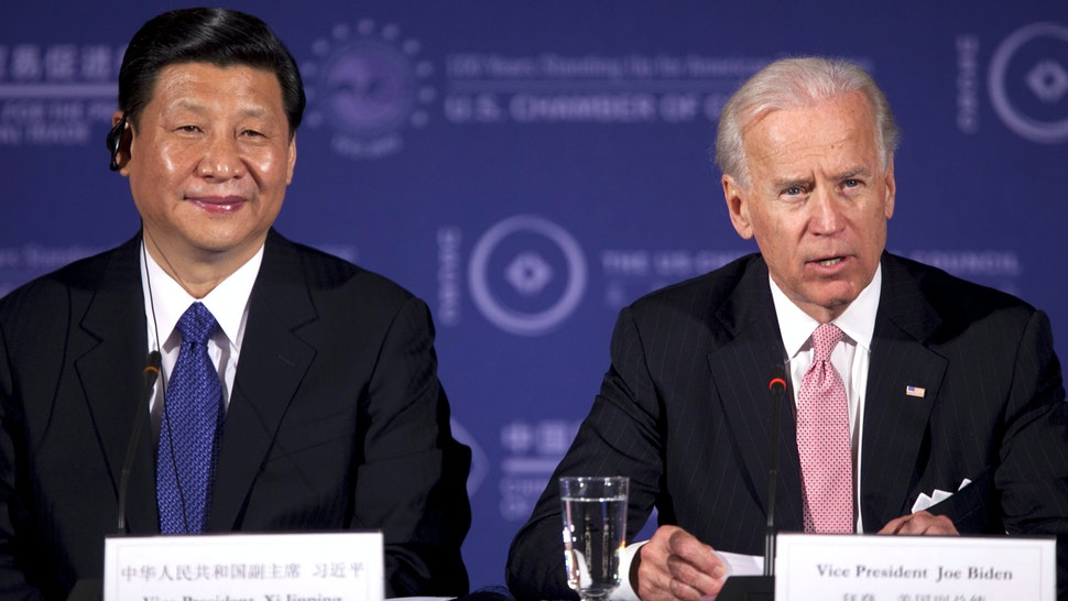 """Xi Jinping, vice president of China, left, listens as U.S. Vice President Joe Biden speaks during the U.S.-China Business Roundtable at the Chamber of Commerce in Washington, D.C., U.S., on Tuesday, Feb. 14, 2012. President Barack Obama told Chinese Vice President Xi Jinping that China's growing economic power brings with it responsibility to work toward """"balanced"""" trade and to recognize the aspirations of all people for greater rights."""