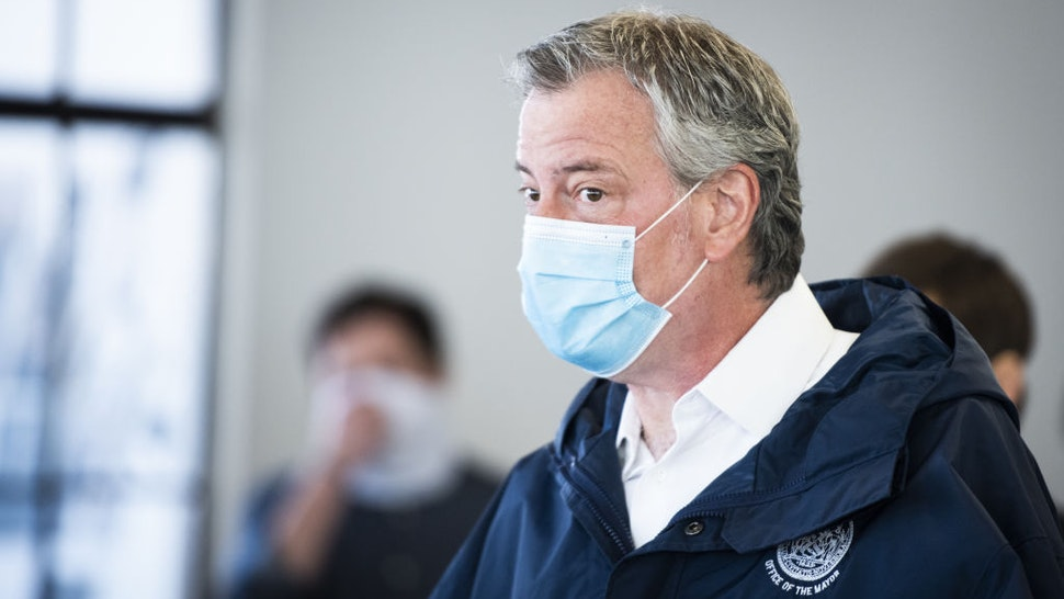 Bill de Blasio, mayor of New York, wears a protective mask while touring the Malia Mills swimwear factory, which has pivoted to manufacturing polypropylene gowns for medical workers, in the Brooklyn borough of New York, U.S., on Wednesday, April 22, 2020. New York City officials intend to enlist thousands of health-care workers next month to conduct hundreds of thousands of diagnostic tests a day, and isolating anyone found to be carrying the disease. Photographer: Mark Kauzlarich/Bloomberg via Getty Images