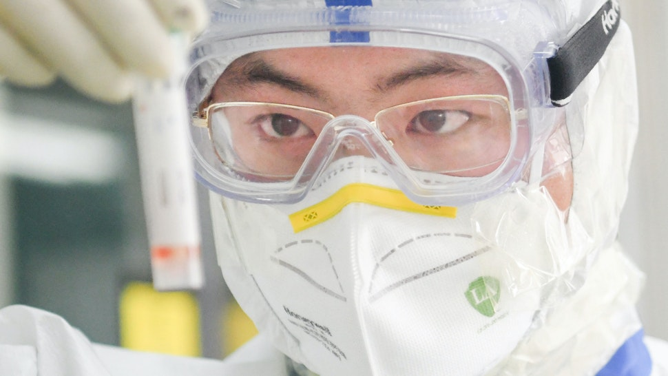 WUHAN, Feb. 13, 2020 -- A staff member works in a laboratory in Wuhan, central China's Hubei Province, Feb. 13, 2020. As a designated service provider of nucleic acid detection of the novel coronavirus, KingMed Diagnostics laboratory in Wuhan conducts non-stop detection service and detects over 2,000 samples from various cities in Hubei Province every day.