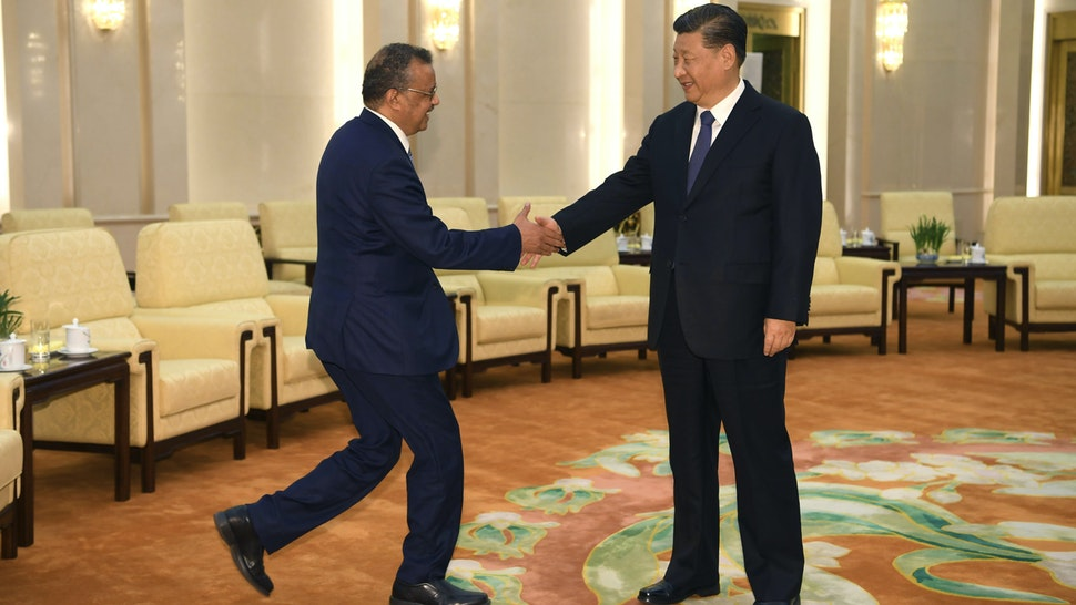 BEIJING, CHINA - JANUARY 28: Tedros Adhanom, Director General of the World Health Organization, (L) shakes hands with Chinese President Xi Jinping before a meeting at the Great Hall of the People, on January 28, 2020 in Beijing, China.