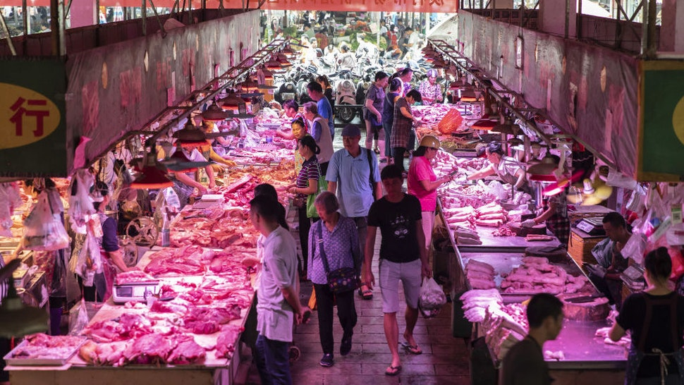 Customers walk past pork stalls at the Dancun Market in Nanning, Guangxi province, China, on Tuesday, Sept. 17, 2019. A protracted U.S. trade war, protests in Hong Kong, soaring food prices and the slowest economic growth in decades are among the many problems facing Chinese President Xi Jinping as he prepares to celebrate 70 years of Communist Party rule.Photographer: Qilai Shen/Bloomberg