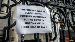 NEW YORK, NY - March 18 MANDATORY CREDIT Bill Tompkins/Getty Images Church closing due to the coronavirus COVID-19 pandemic on March 18, 2020 in New York City.