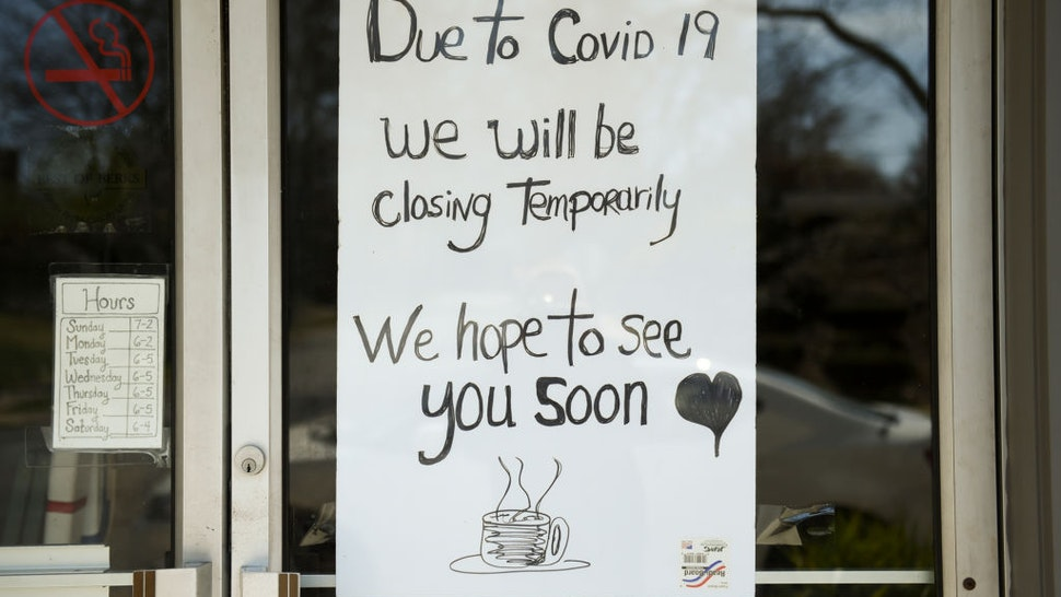 "Wyomissing, PA - April 6: A sign in the window of Dosie Dough Bakery reads, 'Due to Covid 19 we will be closing temporarily. We hope to see you soon,""' on April 6, 2020(Photo by Lauren A. Little/MediaNews Group/Reading Eagle via Getty Images)"