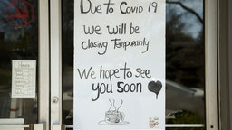 """Wyomissing, PA - April 6: A sign in the window of Dosie Dough Bakery reads, 'Due to Covid 19 we will be closing temporarily. We hope to see you soon,""""' on April 6, 2020(Photo by Lauren A. Little/MediaNews Group/Reading Eagle via Getty Images)"""