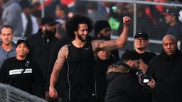 Colin Kaepernick visits with fans following his NFL workout held at Charles R Drew high school on November 16, 2019 in Riverdale, Georgia. (Photo by Carmen Mandato/Getty Images)