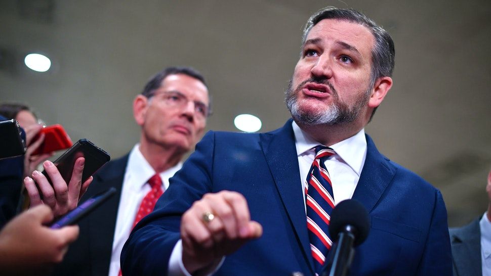 US Senator from Texas, Ted Cruz speaks to the media during a recess in the impeachment trial of US President Donald Trump at the US Capitol in Washington, DC on January 27, 2020. - White House lawyers were to resume their defense of President Donald Trump at his Senate impeachment trial Monday as explosive revelations from former national security advisor John Bolton increased pressure on Republicans to call him as a witness.