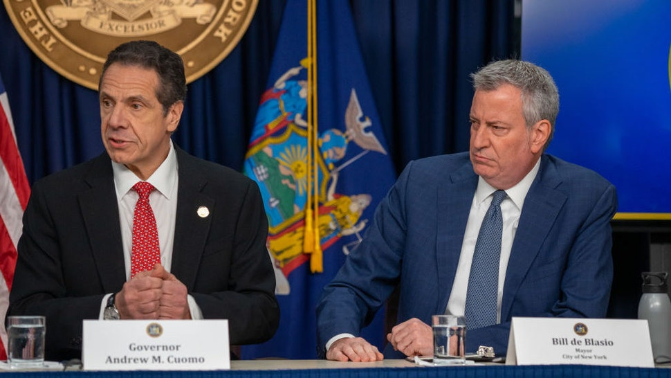 """New York state Gov. Andrew Cuomo and New York City Mayor Bill DeBlasio speak during a news conference on the first confirmed case of COVID-19 in New York on March 2, 2020 in New York City. A female health worker in her 30s who had traveled in Iran contracted the virus and is now isolated at home with symptoms of COVID-19, but is not in serious condition. Cuomo said in a statement that the patient """"has been in a controlled situation since arriving to New York."""" (Photo by David Dee Delgado/Getty Images)"""