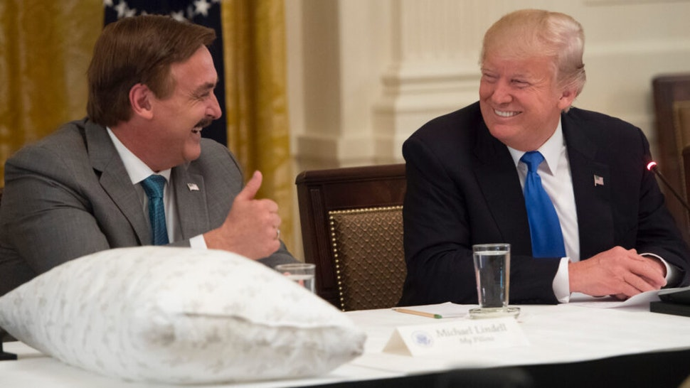 US President Donald Trump speaks alongside Mike Lindell (L), founder of My Pillow, during a Made in America event with US manufacturers in the East Room of the White House in Washington, DC, July 19, 2017.