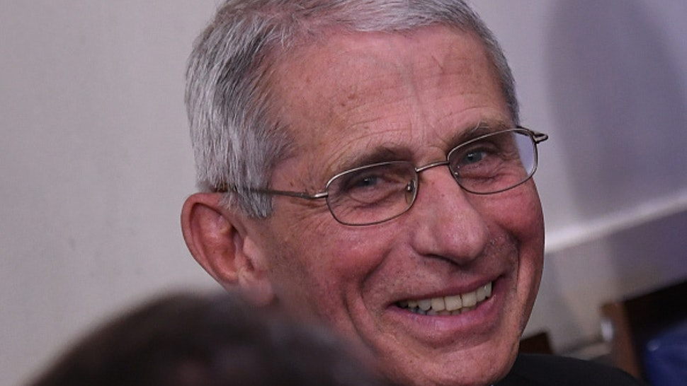 Director of the National Institute of Allergy and Infectious Diseases Anthony Fauci smiles as he listens to US President Donald Trump speak during an unscheduled briefing after a Coronavirus Task Force meeting at the White House on April 5, 2020, in Washington, DC.