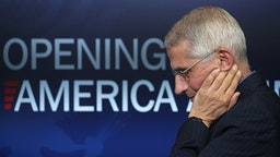 WASHINGTON, DC - APRIL 16: Dr. Anthony Fauci, director of the National Institute of Allergy and Infectious Diseases, listens to U.S. President Donald Trump speak at the daily briefing of the White House Coronavirus Task Force in the briefing room at the White House April 16, 2020 in Washington, DC. The president unveiled the administration's plans today to ease social distancing requirements after an earlier call with the nation's governors.
