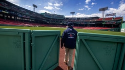 Mike Carpino from Boston Red Sox security leaves the Red Sox bullpen at Fenway Park on April 16, 2020. Fenway Park in Boston remains closed during the coronavirus emergency. (Photo by Stan Grossfeld/The Boston Globe via Getty Images)