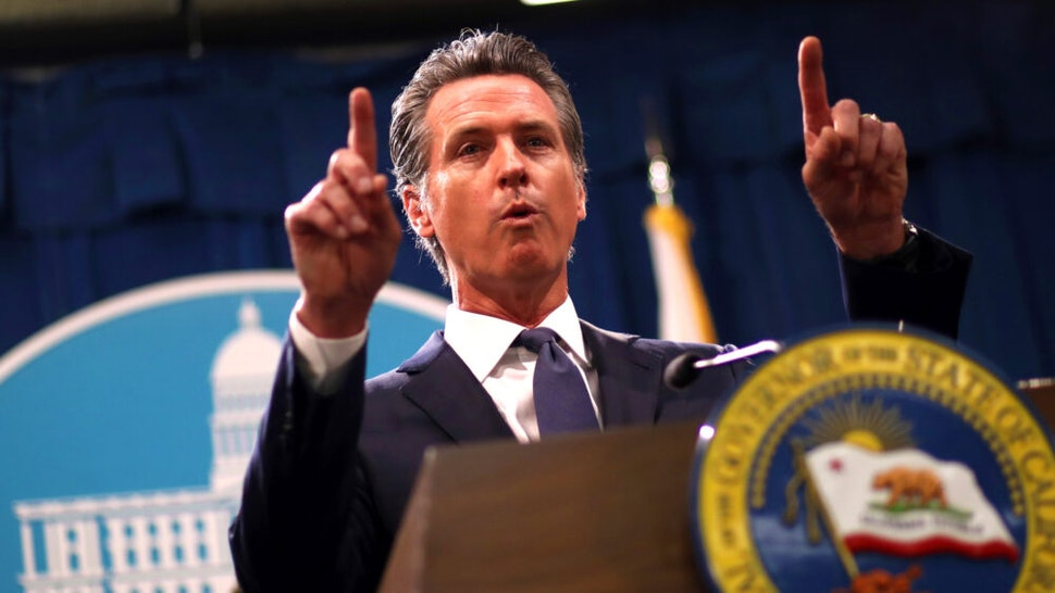 """California Gov. Gavin Newsom speaks during a news conference with California attorney General Xavier Becerra at the California State Capitol on August 16, 2019 in Sacramento, California. California attorney genera Xavier Becerra and California Gov. Gavin Newsom announced that the State of California is suing the Trump administration challenging the legality of a new """"public charge"""" rule that would make it difficult for immigrants to obtain green cards who receive public assistance like food stamps and Medicaid."""