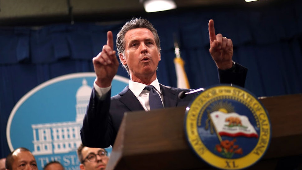 """California Gov. Gavin Newsom speaks during a news conference with California attorney General Xavier Becerra at the California State Capitol on August 16, 2019 in Sacramento, California. California attorney genera Xavier Becerra and California Gov. Gavin Newsom announced that the State of California is suing the Trump administration challenging the legality of a new """"public charge"""" rule that would make it difficult for immigrants to obtain green cards who receive public assistance like food stamps and Medicaid. (Photo by Justin Sullivan/Getty Images)"""
