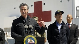 California Governor Gavin Newsom speaks in front of the hospital ship USNS Mercy that arrived into the Port of Los Angeles on Friday, March 27, 2020, to provide relief for Southland hospitals overwhelmed by the coronavirus pandemic. Also attending the press conference were Director Mark Ghilarducci, Cal OES, left, Los Angeles Mayor Eric Garcetti, second from right, and Dr. Mark Ghaly, Secretary of Health and Human Services, far right, along with others not shown. (POOL PHOTOGRAPHS by Carolyn Cole/Los Angeles Times)