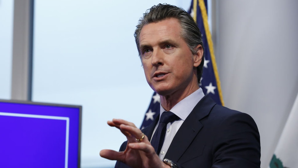 Gavin Newsom, governor of California, speaks during a news conference in Sacramento, California, U.S., on Tuesday, April 14, 2020. Newsomoutlined his plan to lift restrictions in the most-populous U.S. state, saying a reopening depends on meeting a series of benchmarks that would remake daily life for 40 million residents. Photographer: Rich Pedroncelli/AP/Bloomberg