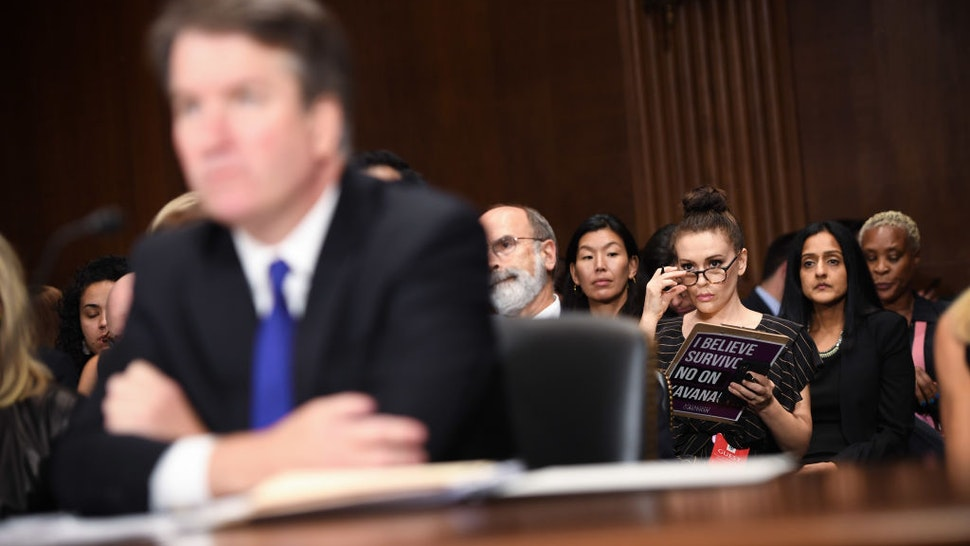 Actress and activist Alyssa Milano (R) listens to Supreme Court nominee Brett Kavanaugh as he testifies before the U.S. Senate Judiciary Committee on Capitol Hill on September 27, 2018 in Washington, DC.