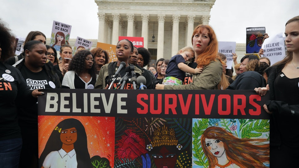 WASHINGTON, DC - SEPTEMBER 24: Women's March co-president Tamika Mallory (at microphones) and Women's March on Washington creator Bob Bland (2nd-R) address a rally against the confirmation of Supreme Court nominee Judge Brett Kavanaugh in front of the court September 24, 2018 in Washington, DC. Hundreds of people from half a dozen progressive organizations, including students from Yale University Law School, protested on Capitol Hill for a #BelieveSurvivors Walkout against Judge Kavanaugh, who has been accused by at least two women of sexual assault. (Photo by Chip Somodevilla/Getty Images)