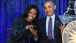 Former First Lady Michelle Obama and former President Barack Obama are seen after their portraits were unveiled at the Smithsonian National Portrait Gallery on Monday February 12, 2018 in Washington, DC.