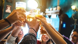 Friends Toasting Beer In Restaurant - stock photo