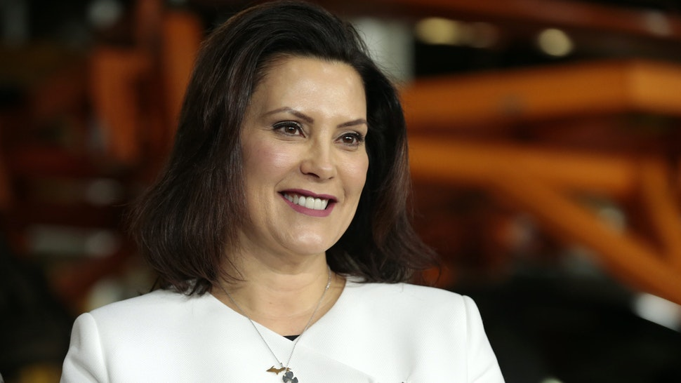 Gretchen Whitmer, governor of Michigan, smiles during an event at the General Motors Co. Orion Assembly plant in Orion Township, Michigan, U.S., on Friday, March 22, 2019. General Motors Co. committed to investing $1.8 billion at plants in six states and to creating 700 new jobs, as the largest U.S. automaker looks to ward off months of criticism by President Donald Trump. Photographer: Jeff Kowalsky/Bloomberg via Getty Images