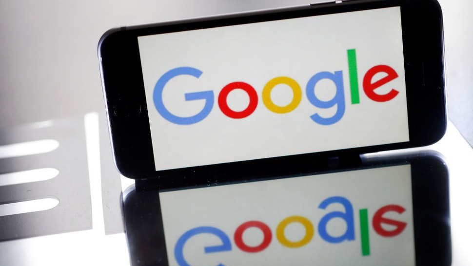 In this photo illustration, the Google logo is displayed on the screen of an iPhone on March 20, 2019 in Paris, France.