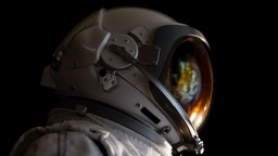 Close-Up Of Astronaut Against Black Background - stock photo