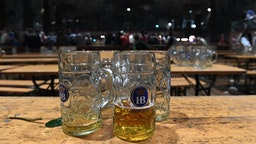 06 October 2019, Bavaria, Munich: Empty beer mugs are placed on the tables in the Hofbräu tent after the traditional sweep. The Oktoberfest ends today. Photo: Felix Hörhager/dpa (Photo by Felix Hörhager/picture alliance via Getty Images)