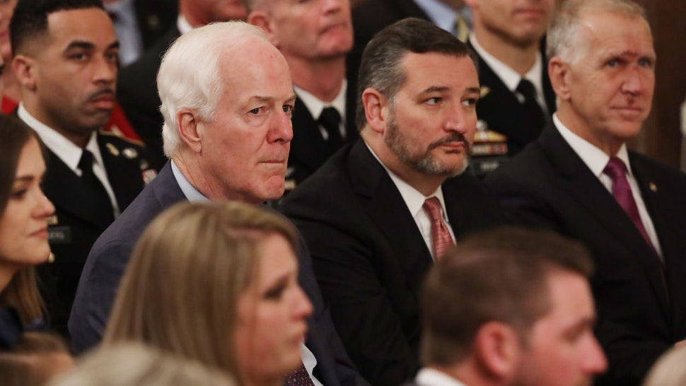 Senate Majority Whip John Cornyn (R-TX), Sen. Ted Cruz (R-TX) and Sen. Thom Tillis (R-NC) attend the Medal of Honor ceremony for U.S. Army Master Sgt. Matthew Williams of Boerne, Texas, in the East Room of the White House October 30, 2019 in Washington, DC.