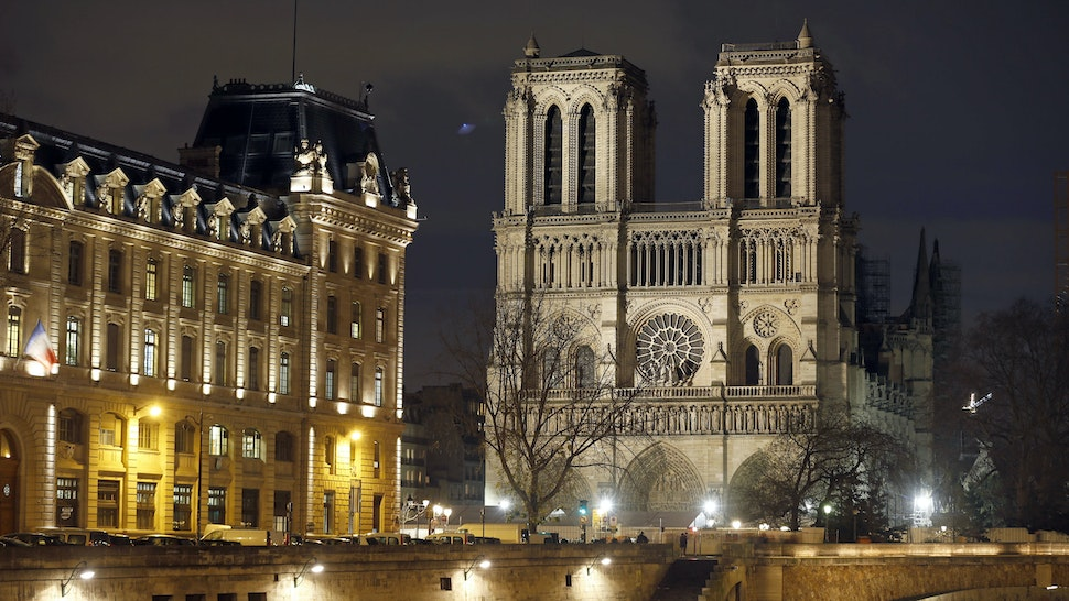 PARIS, FRANCE - DECEMBER 17: The facade of Notre-Dame cathedral is again illuminated at night more than eight months after the fire that ravaged the emblematic monument on December 17, 2019 in Paris, France. A fire broke out in Notre- Dame Cathedral in the evening of Monday, April 15, and quickly spread to the building's wooden roof destroying the famous spire. The cleaning and consolidation phase of the building should continue until the end of the year. (Photo by Chesnot/Getty Images)