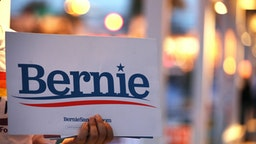 A supporter holds a campaign sign for Senator Bernie Sanders, an Independent from Vermont and 2020 presidential candidate, outside a polling station in the Metropolitan Multi-Service Center in Houston, Texas, U.S., on Tuesday, March 3, 2020. Joe Bidenscored three quick and significant victories in the first results from Super Tuesday, winning the Democratic primaries in Virginia, North Carolina and Alabama. Sanderswon his home state of Vermont. Photographer: Sharon Steinmann/Bloomberg via Getty Images