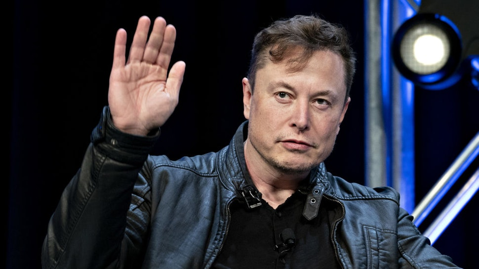 Elon Musk, founder of SpaceX and chief executive officer of Tesla Inc., waves while arriving to a discussion at the Satellite 2020 Conference in Washington, D.C., U.S., on Monday, March 9, 2020.