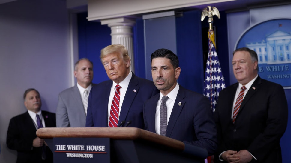 Chad Wolf, acting secretary of the Department of Homeland Security (DHS), center, speaks as U.S. President Donald Trump, third left, listens during a Coronavirus Task Force news conference in the briefing room of the White House in Washington, D.C., U.S., on Friday, March 20, 2020.