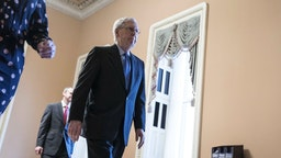 Senate Majority Leader Mitch McConnell, a Republican from Kentucky, walks through the U.S. Capitol in Washington, D.C., U.S., on Tuesday, March 24, 2020.