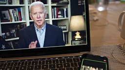 Former Vice President Joe Biden, 2020 Democratic presidential candidate, speaks during a virtual press briefing on a laptop computer in this arranged photograph in Arlington, Virginia, U.S., on Wednesday, March 25, 2020. During the livestreamed news conference today, Biden said he didn't see the need for another debate, which the Democratic National Committee had previously said would happen sometime in April. Photographer: Andrew Harrer/Bloomberg via Getty Images