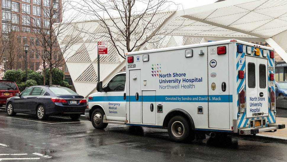 Medical emergency vehicle parked next to Lenox Health Medical Pavilion part of Northwell Health system in Greenwich Village of Manhattan.
