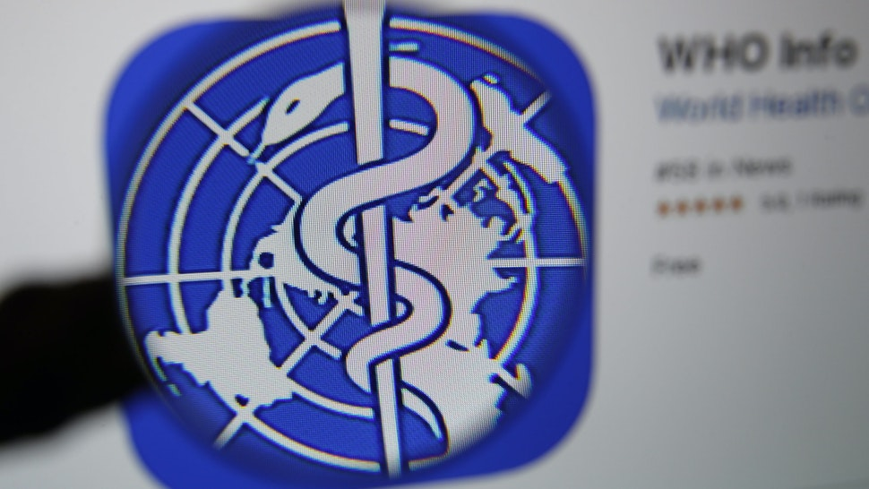 The logo for the World Health Organization (WHO) WHO Info application is displayed on a computer screen in an arranged photograph taken in Bern, Switzerland, on Tuesday, March 31, 2020. The Covid-19 pandemic has triggered a seismic wave of health awareness and anxiety, which is energizing a new category of virus-fighting tech and apps. Photographer: Stefan Wermuth/Bloomberg via Getty Images