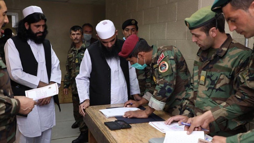 Procedures of Taliban prisoners are being made, in Kabul, Afghanistan on April 9, 2020. The Afghan government released 100 Taliban prisoners following a presidential decree, despite the insurgents' withdrawal from intra-Afghan peace talks.