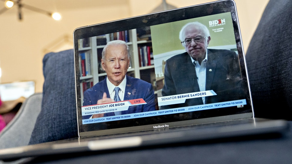 ormer Vice President Joe Biden, presumptive Democratic presidential nominee, left, speaks as Senator Bernie Sanders, an Independent from Vermont, right, listens during a virtual event seen on an Apple Inc. laptop computer in Arlington, Virginia, U.S., on Monday, April 13, 2020. Sanders endorsed Biden during the joint livestream saying that Americans of all political affiliations should back the former vice president. Photographer: Andrew Harrer/Bloomberg via Getty Images