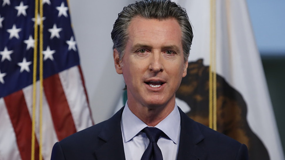 Gavin Newsom, governor of California, speaks during a news conference in Sacramento, California, U.S., on Tuesday, April 14, 2020. Newsomoutlined his plan to lift restrictions in the most-populous U.S. state, saying a reopening depends on meeting a series of benchmarks that would remake daily life for 40 million residents.
