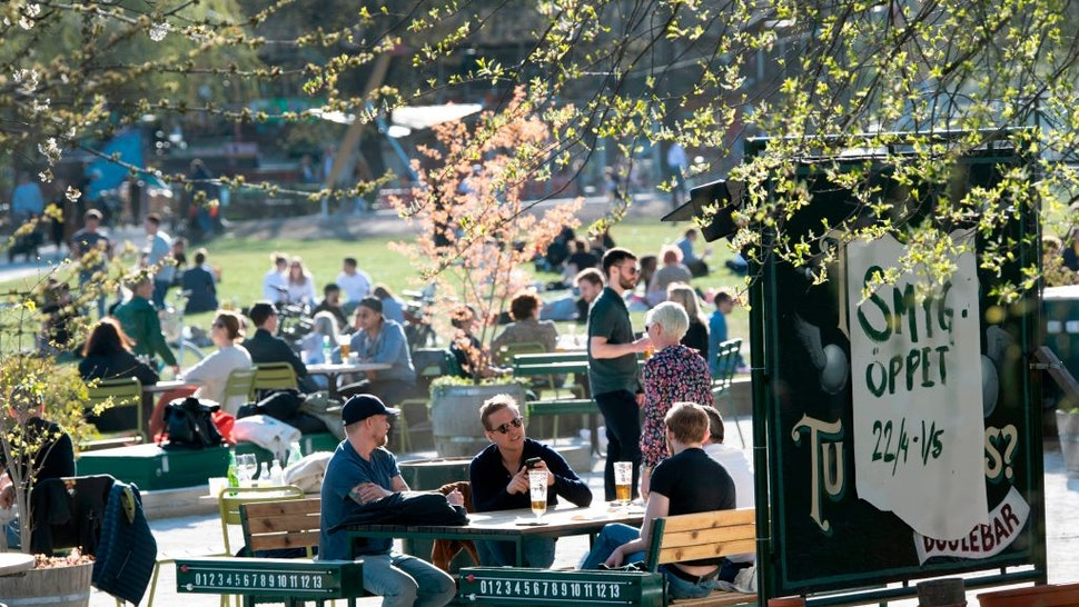 People enjoy warm and spring-like weather with high temperatures on April 22, 2020, in Stockholm.