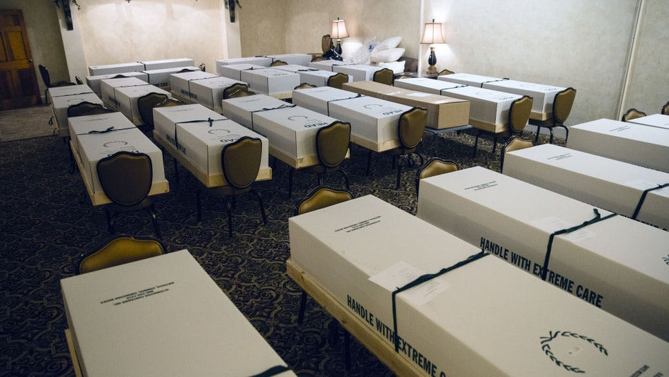 Cremation boxes, mostly containing the bodies of suspected covid-19 patients, sit in a room at a funeral home in the Queens borough of New York, U.S., on Wednesday, April 29, 2020.