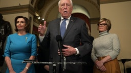 WASHINGTON, DC - MARCH 13: U.S. House Majority Leader Rep. Steny Hoyer (D-MD) speaks to members of the media as Speaker of the House Rep. Nancy Pelosi (D-CA), and Rep. Susie Lee (D-NV) listen at the U.S. Capitol March 13, 2020 in Washington, DC. Speaker Pelosi held a briefing on the Coronavirus Aid Package Bill that will deal with the outbreak of COVID-19. (Photo by Alex Wong/Getty Images)